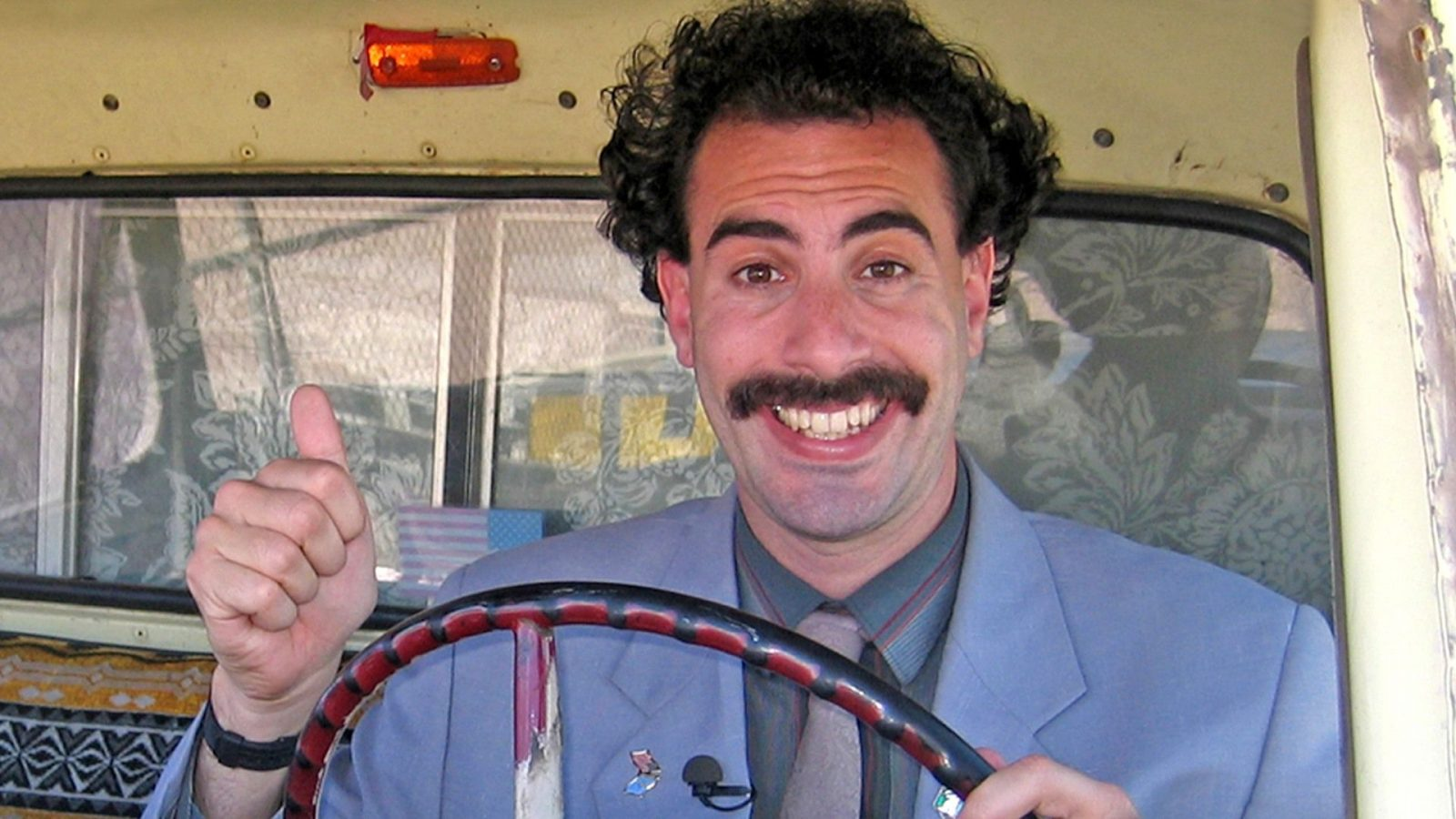 Is nice! Watch the first trailer for the secretly filmed Borat 2